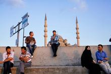 Image of people in Istanbul sitting in evening sunlight