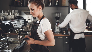 Image of young female worker in a café