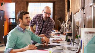 Shutterstock image of designers working together at desk